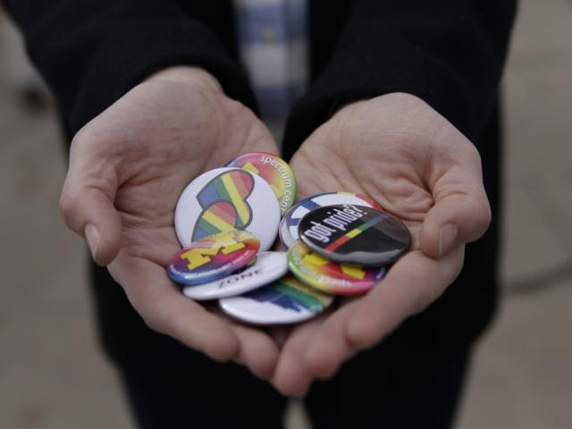 Photo of hands holding buttons