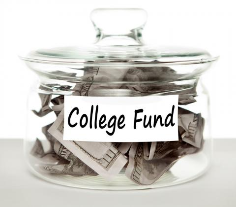 "Jar of money labeled ""college fund"""