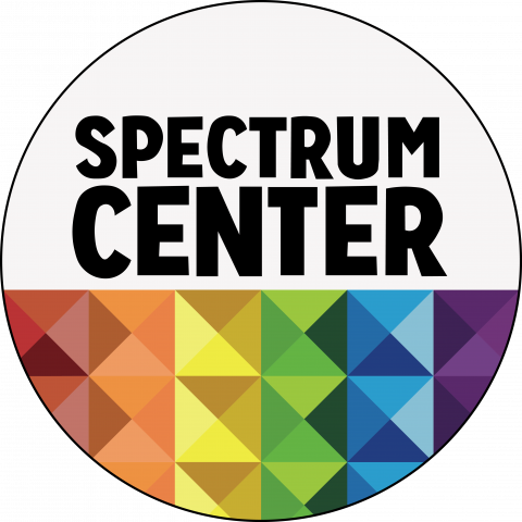 Spectrum Center's affinity logo, a circle with text in the center the says Spectrum Center, the bottom half is prisms in the colors of the rainbow.
