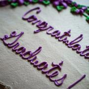 "Photo of a cake with ""Congratulations Graduates!"" on top"