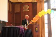 Photo of John Evans Speaking at Lavender Graduation